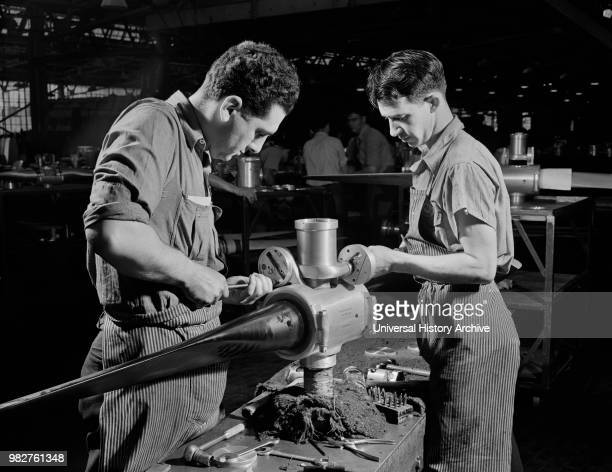 Leo Diana and George O'Meara working Assembling Propeller Blade for Military Aircraft at Manufacturing Plant Hartford Connecticut USA Andreas...