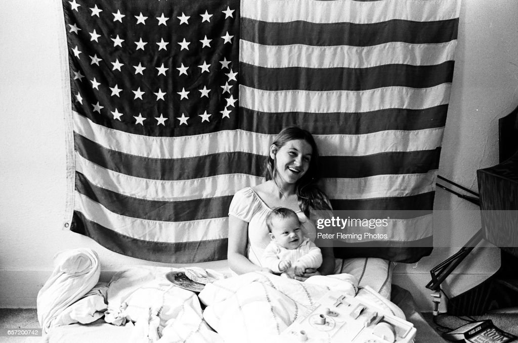 Leo DiCaprio and his mother pose for a portrait in their home in front of American flag in July 1975 in Hollywood, California