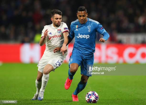Leo Dubois of Olympique Lyonnais and Alex Sandro of Juventus during the UEFA Champions League round of 16 first leg match between Olympique Lyon and...