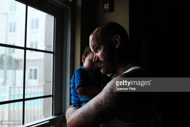 Leo Figueroa and his son Leo Jr wait out Hurricane Irma in a hotel on September 10 2017 in Fort Myers Florida With businesses closed thousands in...