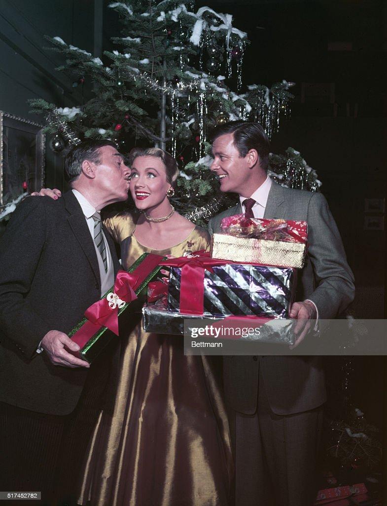 A Christmas Kiss.Leo G Carroll Gives Anne Jeffreys A Christmas Kiss After