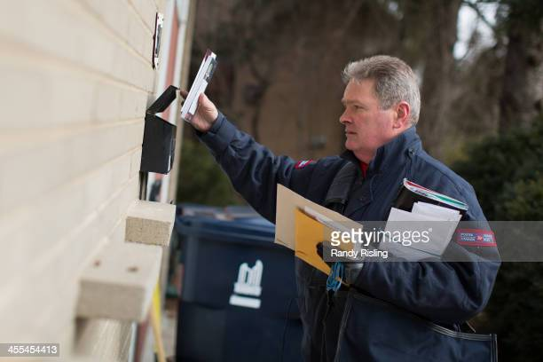 Leo Gaspari delivers mail for Canada Post along his route near Don Mills Rd and Lawrence Ave E Canada Post unveiled a plan that includes phasing out...