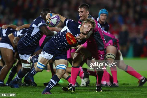 Leo Ghirard of Agen is held up by Jake Polledri of Gloucester during the European Rugby Challenge Cup Pool 3 match between Gloucester and Agen at...