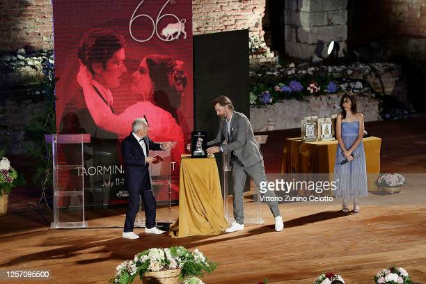 Leo Gullotta and Nikolaj CosterWaldau attend the closing night of the Taormina Film Festival on July 19 2020 in Taormina Italy