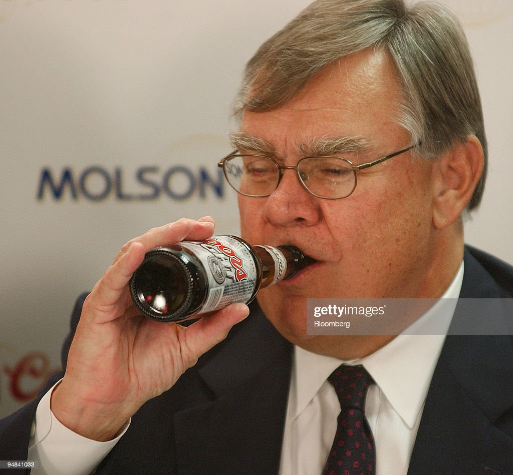 Leo kiely ceo of coors drinks from a bottle of coors light leo kiely ceo of coors drinks from a bottle of coors light beer during mozeypictures Gallery
