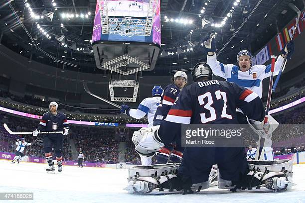 Leo Komarov and Tuomo Ruutu of Finland celebrate a goal by Juuso Hietanen in the third period against Jonathan Quick of the United States during the...