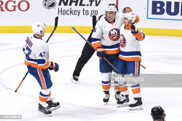 Leo Komarov Andrew Ladd and Valtteri Filppula of the New York Islanders celebrate Filppula's secondperiod goal during the game against the Los...