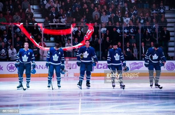 Leo Komarov Morgan Rielly Ron Hainsey Nazem Kadri and Patrick Marleau of the Toronto Maple Leafs stand for the national anthems before playing the...