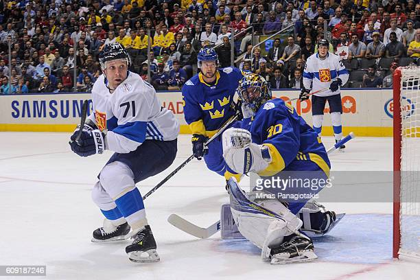 Leo Komarov of Team Finland and goaltender Henrik Lundqvist of Team Sweden look towards the play during the World Cup of Hockey 2016 at Air Canada...
