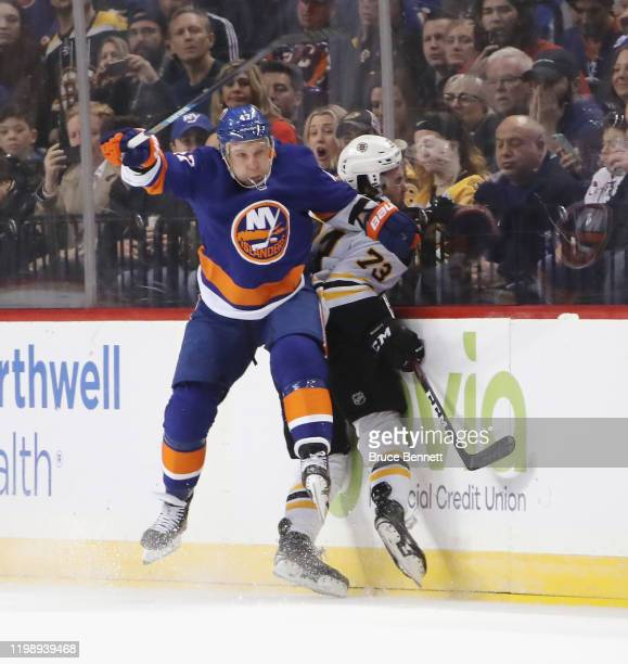 Leo Komarov of the New York Islanders steps into Charlie McAvoy of the Boston Bruins during the third period at the Barclays Center on January 11,...