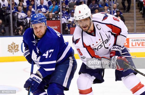 Leo Komarov of the Toronto Maple Leafs and Alex Ovechkin of the Washington Capitals during the third period in Game Six of the Eastern Conference...