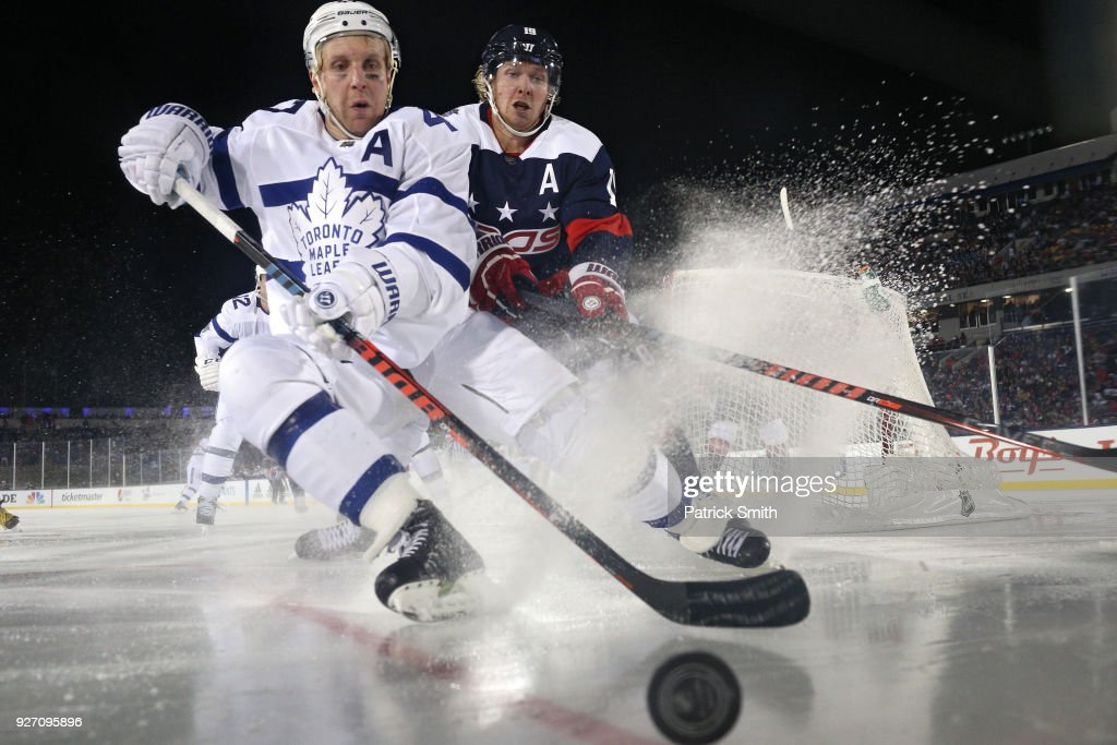 Leo Komarov #47 of the Toronto Maple Leafs and Nicklas Backstrom #19 of the Washington Capitals battle for the puck during the third period in the Coors Light NHL Stadium Series at Navy-Marine Corps Memorial Stadium on March 3, 2018 in Annapolis, Maryland.