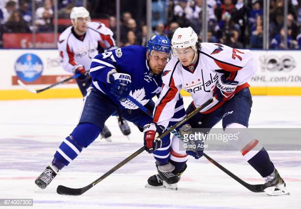 Leo Komarov of the Toronto Maple Leafs battles for position with TJ Oshie of the Washington Capitals during the third period in Game Six of the...