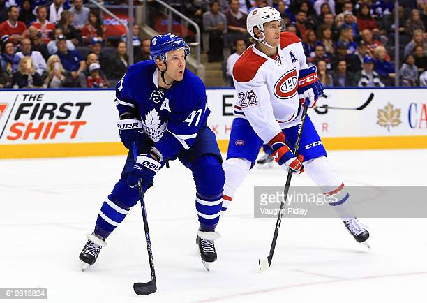 Leo Komarov of the Toronto Maple Leafs battles for space with Jeff Petry of the Montreal Canadiens during an NHL preseason game at Air Canada Centre...