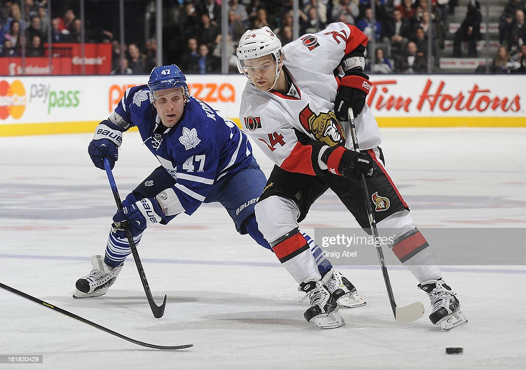 Leo Komarov #47 of the Toronto Maple Leafs battles for the puck with Stephane Da Costa #24 of the Ottawa Senators during NHL game action February 16, 2013 at the Air Canada Centre in Toronto, Ontario, Canada.