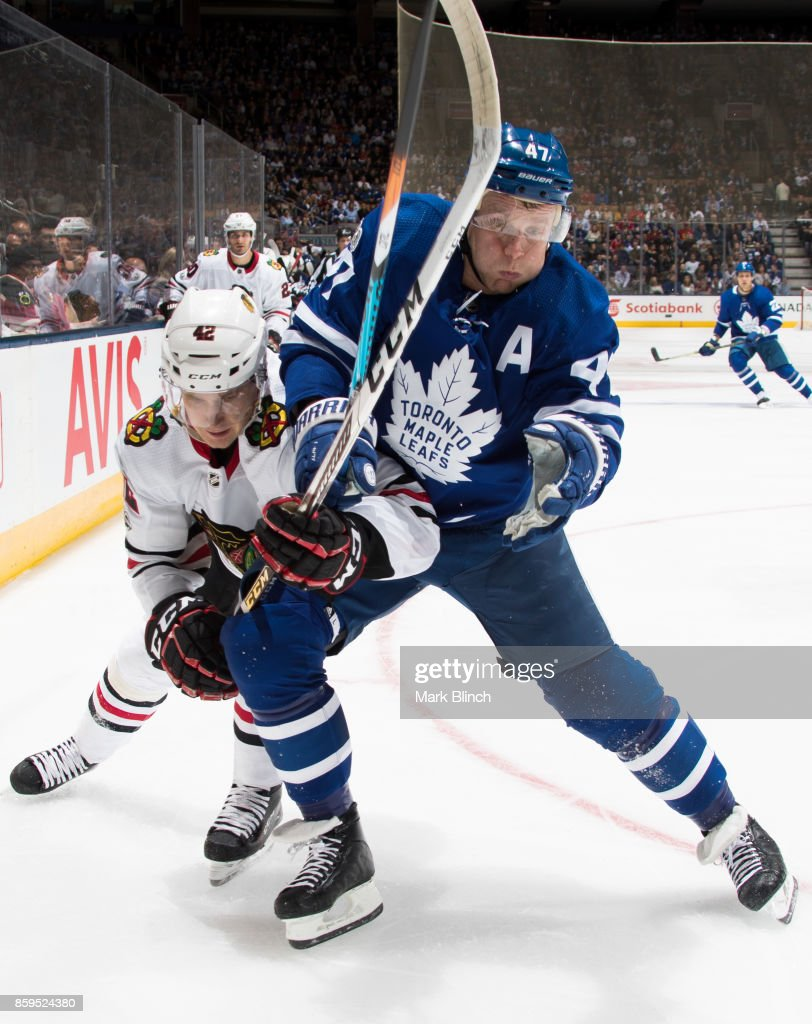 Leo Komarov #47 of the Toronto Maple Leafs battles with Gustav Forsling #42 of the Chicago Blackhawks during the first period October 9, 2017 at the Air Canada Centre in Toronto, Ontario, Canada.