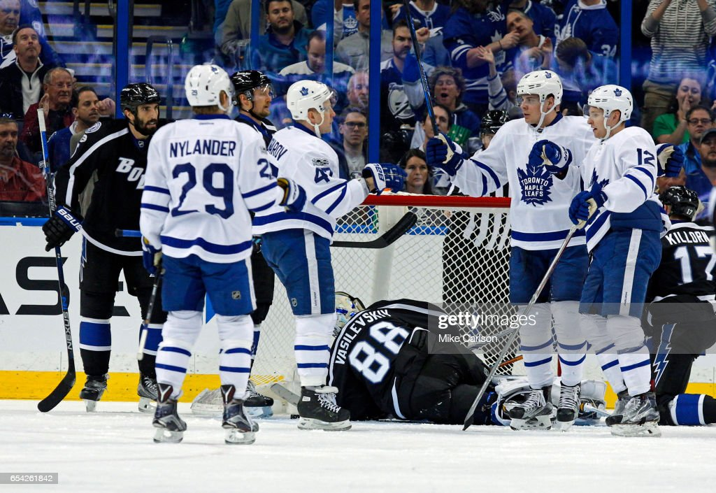Leo Komarov #47 of the Toronto Maple Leafs celebrates a goal with Auston Matthews #34, Connor Brown #12 and William Nylander #29 as Jason Garrison #5, Andrei Vasilevskiy #88 and Alex Killorn #17 of the Tampa Bay Lightning during the second period at the Amalie Arena on March 16, 2017 in Tampa, Florida.