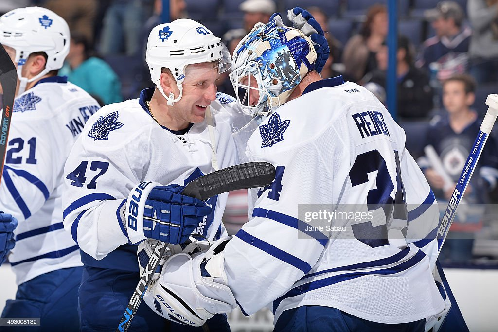 Leo Komarov #47 of the Toronto Maple Leafs celebrates with goaltender James Reimer #34 of the Toronto Maple Leafs after defeating the Columbus Blue Jackets 6-3 on October 16, 2015 at Nationwide Arena in Columbus, Ohio.