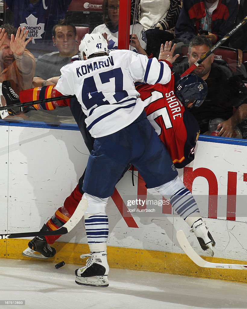 Leo Komarov #47 of the Toronto Maple Leafs checks Drew Shore #15 of the Florida Panthers into the boards at the BB&T Center on April 25, 2013 in Sunrise, Florida. The Maple Leafs defeated the Panthers 4-0.