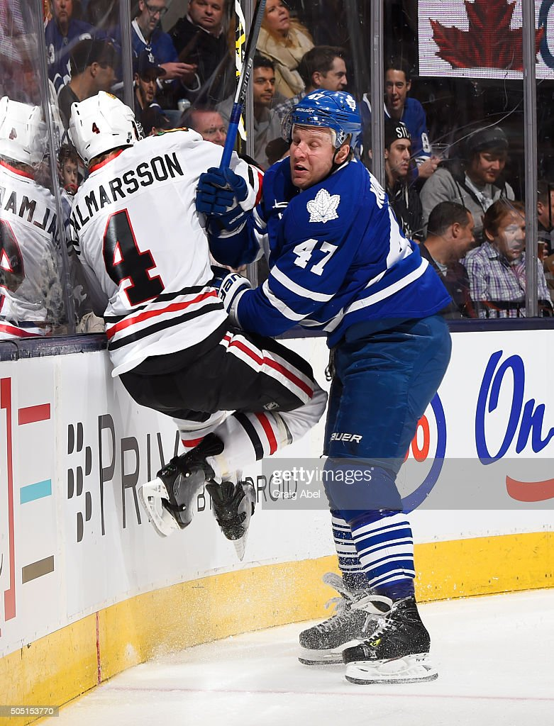 Leo Komarov #47 of the Toronto Maple Leafs checks Niklas Hjalmarsson of the Chicago Blackhawks during NHL game action January 15, 2016 at Air Canada Centre in Toronto, Ontario, Canada.
