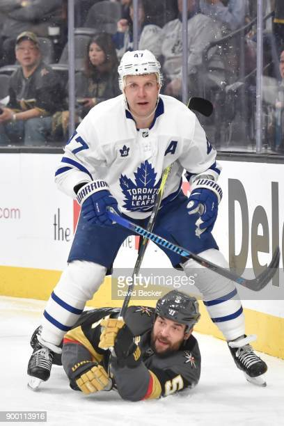 Leo Komarov of the Toronto Maple Leafs collides with Deryk Engelland of the Vegas Golden Knights during the game at TMobile Arena on December 31 2017...
