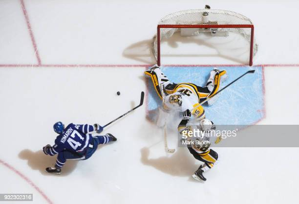 Leo Komarov of the Toronto Maple Leafs goes to the net against Tristan Jarry and Kris Letang of the Pittsburgh Penguins during the first period at...