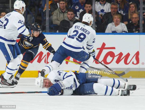 Leo Komarov of the Toronto Maple Leafs reacts after being injured in a second period collision with teammate William Nylander during an NHL game...
