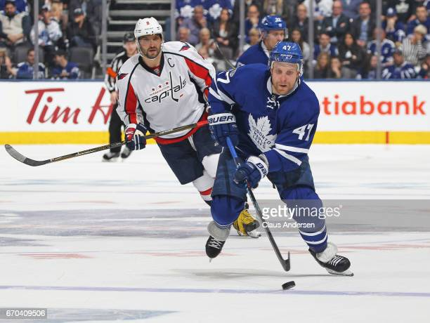 Leo Komarov of the Toronto Maple Leafs skates away with the puck from Alex Ovechkin of the Washington Capitals in Game Four of the Eastern Conference...