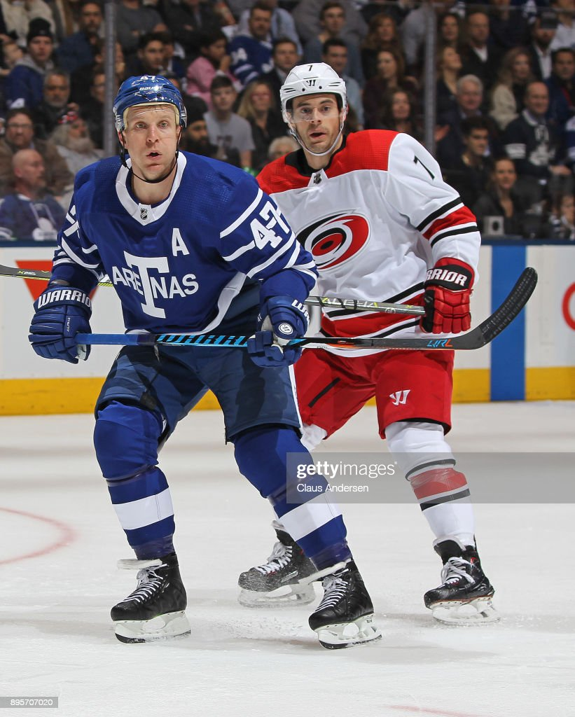 Leo Komarov #47 of the Toronto Maple Leafs skates in front of Derek Ryan #7 of the Carolina Hurricanes during an NHL game at the Air Canada Centre on December 19, 2017 in Toronto, Ontario, Canada. The Maple Leafs defeated the Hurricanes 8-1.