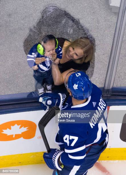 Leo Komarov of the Toronto Maple Leafs speaks to his wife Juulia Manner before the Leafs face the Ottawa Senators at the Air Canada Centre in their...
