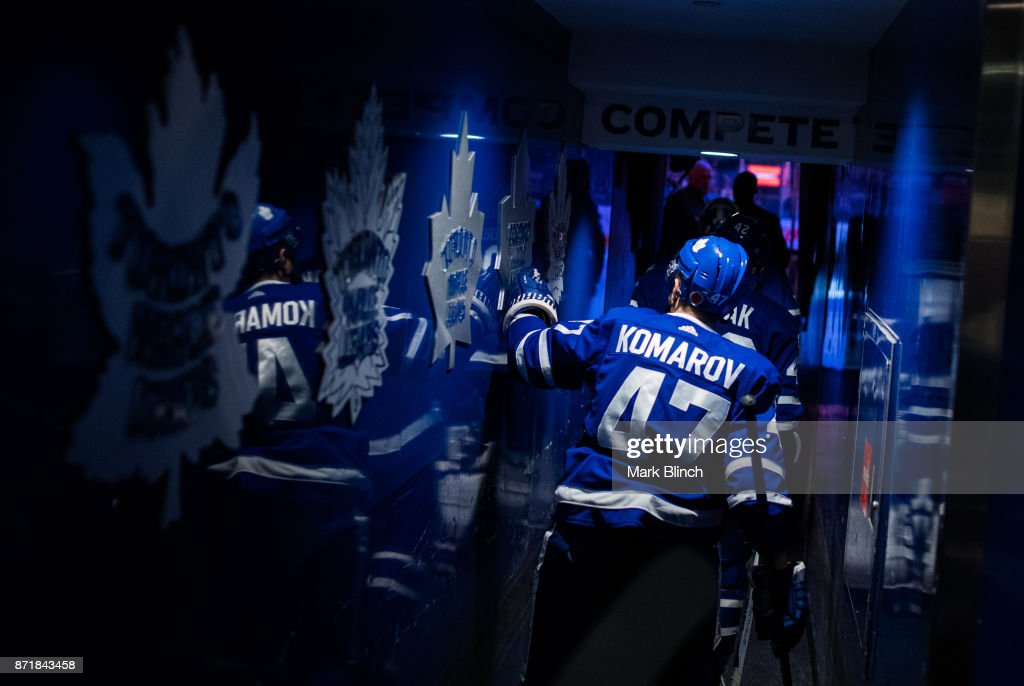 Leo Komarov #47 of the Toronto Maple Leafs touches the team logo on the wall on the way to warm up before facing the Minnesota Wild at the Air Canada Centre on November 8, 2017 in Toronto, Ontario, Canada.