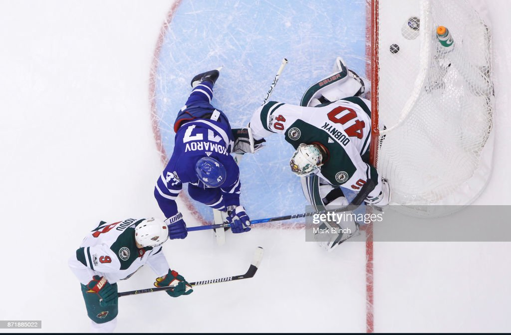 Leo Komarov #47 of the Toronto Maple Leafs watches the puck go into the net behind Devan Dubnyk #40 of the Minnesota Wild on a goal by Nazem Kadri #43 of the Toronto Maple Leafs (not seen) during the third period at the Air Canada Centre on November 8, 2017 in Toronto, Ontario, Canada.