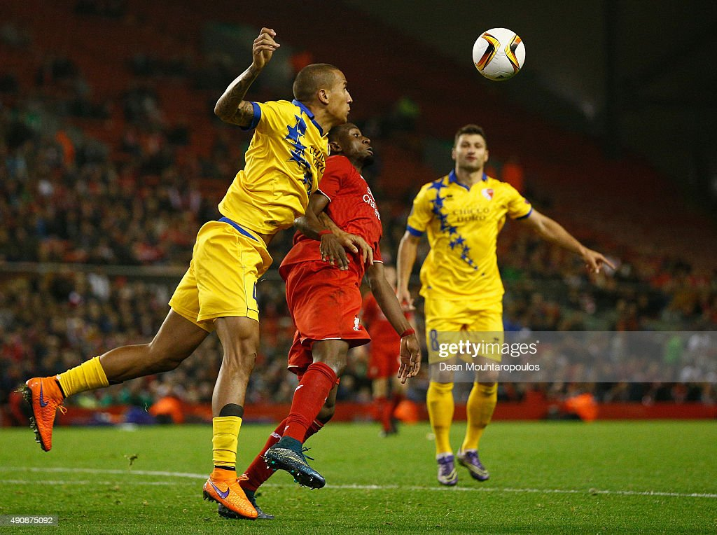 Leo Lacroix of FC Sion and Divock Origi of Liverpool compete for the ball during the UEFA Europa League group B match between Liverpool FC and FC Sion at Anfield on October 1, 2015 in Liverpool, United Kingdom.