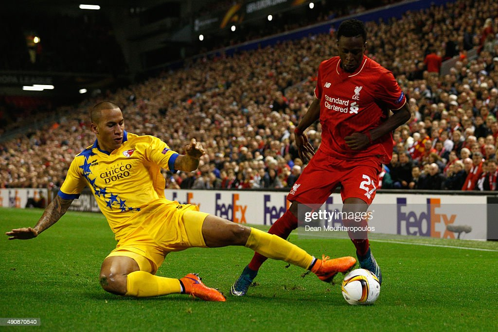 Leo Lacroix of FC Sion tackles Divock Origi of Liverpool during the UEFA Europa League group B match between Liverpool FC and FC Sion at Anfield on October 1, 2015 in Liverpool, United Kingdom.