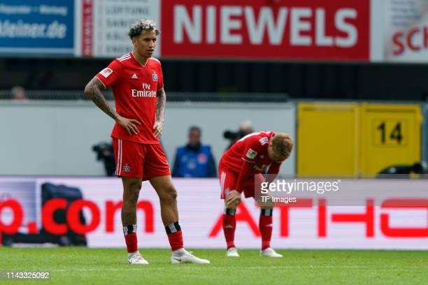 Leo Lacroix of Hamburger SV and Gotoku Sakai of Hamburger SV look dejected after the Second Bundesliga match between SC Paderborn 07 and Hamburger SV...