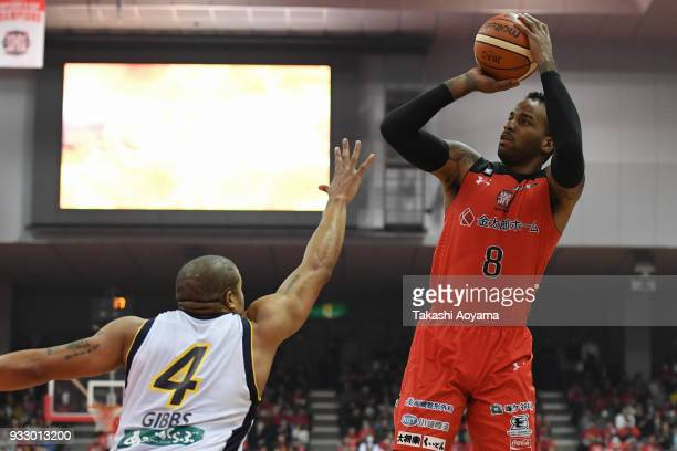 Leo Lyons of the Chiba Jets shoots while under pressure from Jeff Gibbs of the Tochigi Brex during the BLeague game between Chiba Jets and Tochigi...