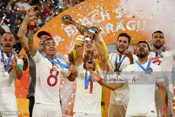 Leo Martins of Portugal lifts the FIFA Beach Soccer World Cup trophy following his team's victory in the final match against Italy at Estadio...