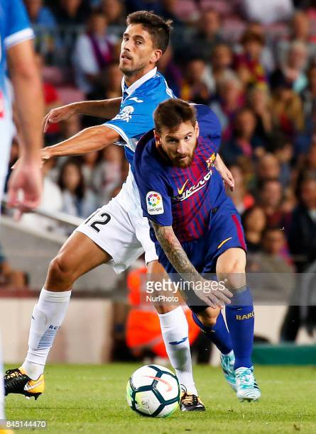 Leo Messi and Didac Vila during La Liga match between FC Barcelona v RCD Espanyol in Barcelona on September 09 2017