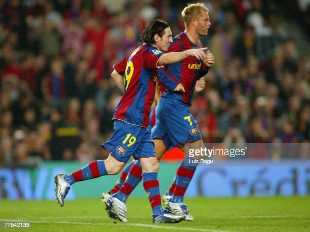 Leo Messi and Eidur Gudjohnsen of Barcelona cellebratign Messi's goal during the La Liga match between FC Barcelona and UD Almeria played at the Camp...