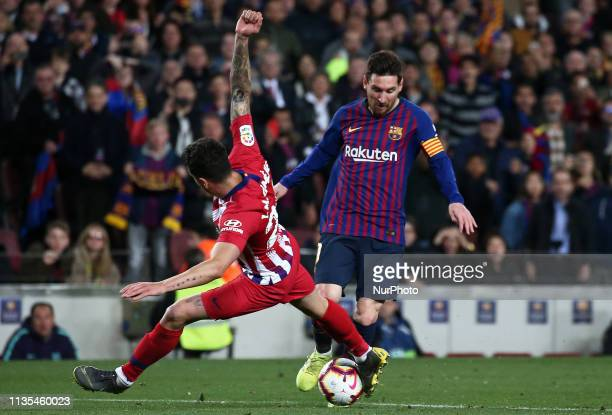 Leo Messi and Gimenez during the match between FC Barcelona and Atletico de Madrid corresponding to the week 30 of the Liga Santander played at the...