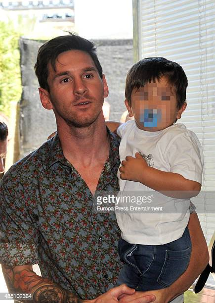 Leo Messi and his son Thiago Messi attend the farewell event as Pedro Rodriguez leaves FC Barcelona on August 24 2015 in Barcelona Spain