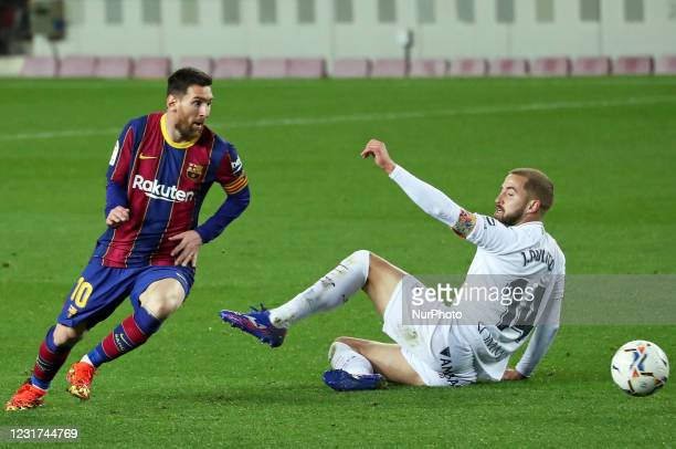 Leo Messi and Jorge Pulido during the match between FC Barcelona and SD Huesca, corresponding to the week 27 of the Liga Santander, played at the...
