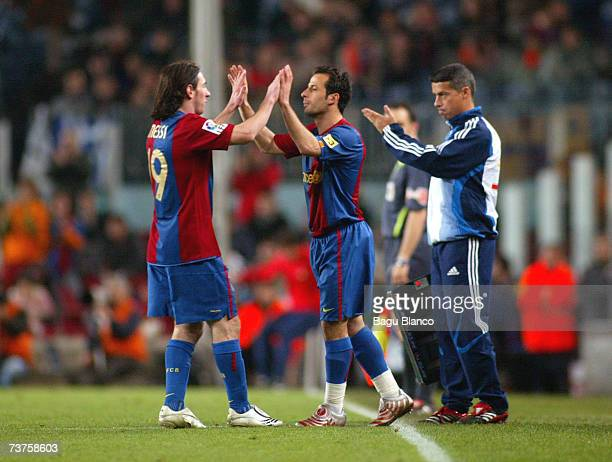 Leo Messi and Ludovic Giuly of Barcelona during the match between FC Barcelona and Deportivo La Coruna of La Liga at the Camp Nou stadium on March 31...