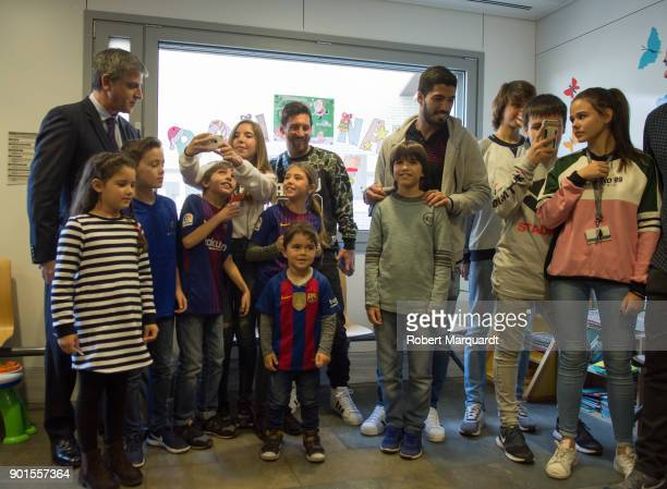 Leo Messi and Luis Suarez visit the childern's section of Hospital Sant Pau on January 5 2018 in Barcelona Spain