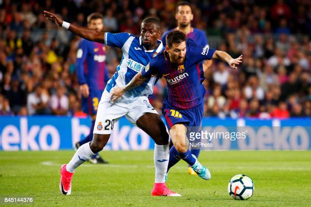 Leo Messi and Pape Diop during La Liga match between FC Barcelona v RCD Espanyol in Barcelona on September 09 2017