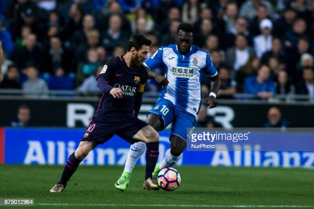 Leo Messi FC Barcelona defended by Felipe Caicedo of RCD Espanyol during the Spanish championship Liga football match between RCD Espanyol vs FC...