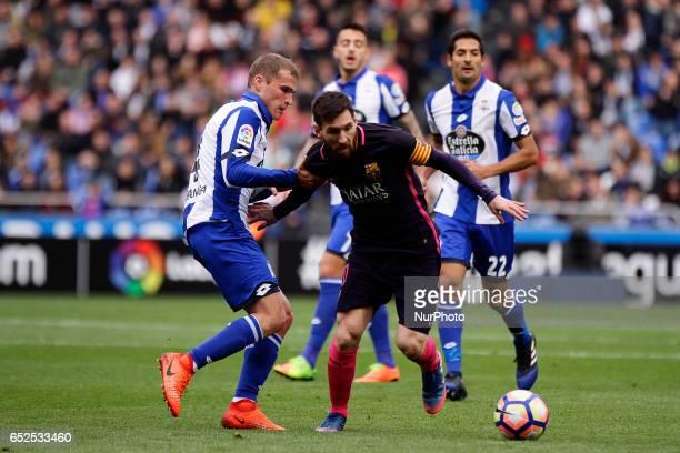 Leo Messi forward of FC Barcelona battles for the ball with Alex Bergantiños midfielder of Deportivo de La Coruña during the La Liga Santander match...