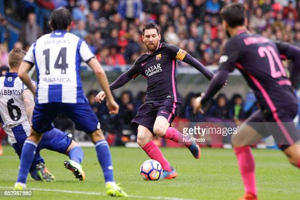 Leo Messi forward of FC Barcelona drives the ball during the La Liga Santander match between Deportivo de La Coruña and FC Barcelona at Riazor...