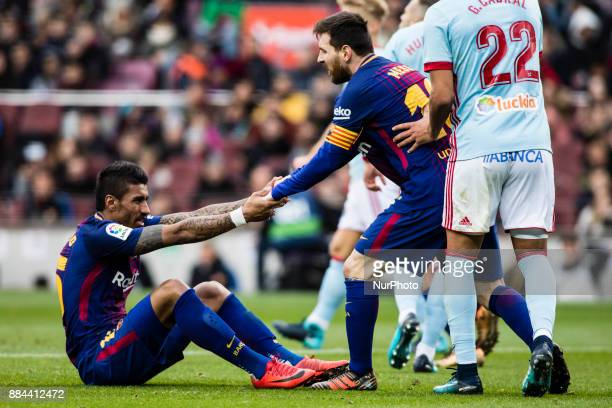 Leo Messi from Argentina of FC Barcelona and Jos Paulo Bezerra Paulinho from Brazil Of FC Barcelona during the La Liga match between FC Barcelona v...