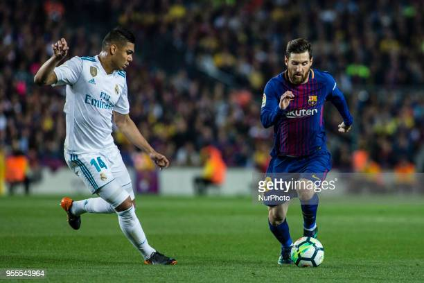 10 Leo Messi from Argentina of FC Barcelona defended by 14 Casemiro from Brazil of Real Madrid during the La Liga derby football match between FC...